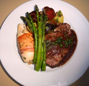 Proscutto wrapped Chicken Breast, Beef Tenderloin, and Asparagus Plated Dinner