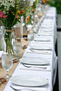 Tables, centerpieces, and flowers set by the Voila Team