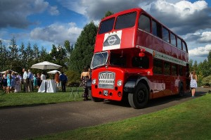 Guests arrive by wedding bus