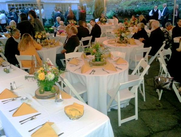 At leach gardens the wedding reception dining tables are set by voila catering