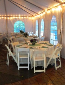 Dinner tables set under the canopy at leach botanical gardens