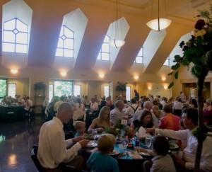 Guests seated for family style dinner reception in portland