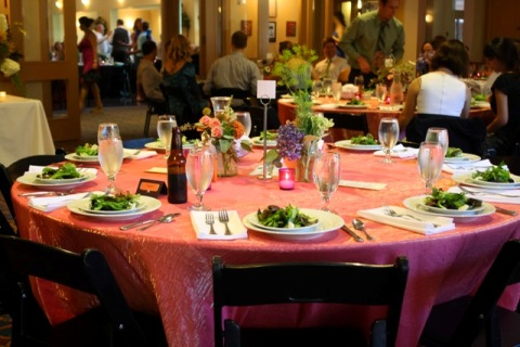 Guest tables set for catered dinner