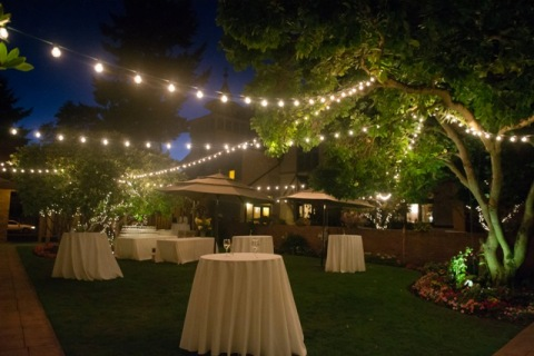 Outdoor wedding reception at night
